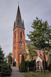 Church of red brick tower. In Oborniki in Poland Royalty Free Stock Photos