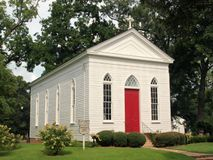 Church with Red Door. A small Episcopal church in Raymond, Misssissippi Royalty Free Stock Photos