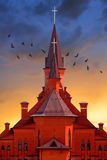 Church. Red church at sunset with birds Royalty Free Stock Images
