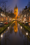 Church reflected in a canal in Delft, The Netherlands Royalty Free Stock Images