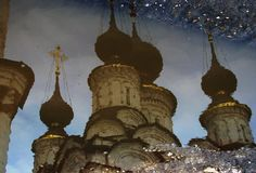 A church reflected in a puddle in Suzdal, Russia. Suzdal is a town northeast of Moscow, Russia. It`s part of the Golden Ring cluster of ancient towns. The Suzdal Royalty Free Stock Photo