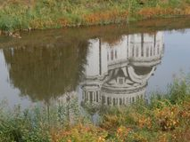 Church reflected in the water. In Sighisoara, Romania Royalty Free Stock Images