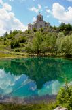 Church with reflection in beautiful turquoise lake   Stock Photography