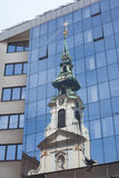 Church reflection on modern glass facade Royalty Free Stock Photography