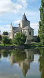 Church with reflection in river Stock Image