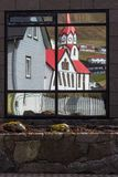 Church. Reflection of Sandavágur church in the Faroe Islands Royalty Free Stock Photo