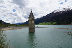 Church at Reschensee Lago di Resia in north italy Stock Image