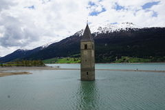 Church at Reschensee Lago di Resia in north italy Royalty Free Stock Images
