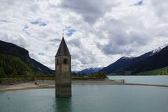 Church at Reschensee Lago di Resia in north italy Royalty Free Stock Image