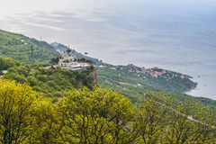 Church of the Resurrection of Christ. Orthodox church over the village of Foros, built in 1892 on a steep cliff - the Red Rock. The height of the building royalty free stock photos