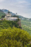 Church of the Resurrection of Christ. Orthodox church over the village of Foros, built in 1892 on a steep cliff - the Red Rock. The height of the building royalty free stock images