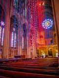 Church with Ribbons of Light. A Church with light streaming through suspended coloured ribbons Royalty Free Stock Image
