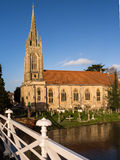 Church on River Thames in Marlow, England. All Saints Church seen from the suspension bridge over the River Thames in Marlow. Buckinghamshire, England Royalty Free Stock Photos
