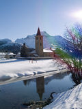 Church by river in winter snow Stock Photography