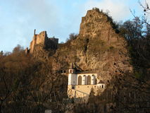 The Church in the Rock and Castle Ruins. A view of the Church in the Rock flanked by two castle ruins in Idar-Oberstein, Germany. Photograph shot near sunset Stock Photo