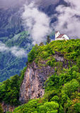 Church on a rock in swiss Alps mountains Royalty Free Stock Photos