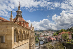 Church and roman bridge in historical town Amarante royalty free stock images