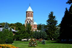 Church in Romania. Church of Curtea de Arges is a Romanian Orthodox cathedral, gardens, blue sky, colors, three, sightseeing, a trip to Romania, background Royalty Free Stock Image