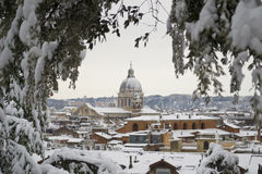 Church of Rome under snowfall. This picture was taken february 4th 2012, after one of the heaviest snowfall in Rome since 1985. This is the view from Pincio hill Royalty Free Stock Image