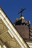 Church roof with cross. Past facture roof of church  with cross on blue sky Royalty Free Stock Images
