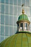Church Roof with Office Block. Green-domed church roof with glass windowed office block in background Royalty Free Stock Photography