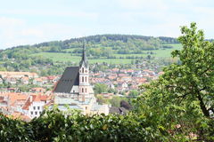 Church and roofs in Cesky Krumlov Stock Image