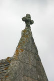 Church rooftop with crucifix. Very old church rooftop with crucifix, overgrown with lichen Royalty Free Stock Image