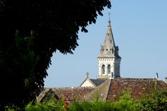 Church and rooftops in the Indre region of central France royalty free stock photography
