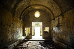 Church Ruin. Interior of the ruin of a medieval church with bright light from its door Royalty Free Stock Photos