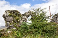 Church Ruins with Window Arch. Church Ruins hidden by vibrant green bush on the west coast of Ireland royalty free stock photography