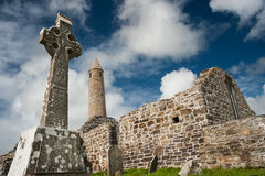 Church ruins and medieval round tower Stock Image