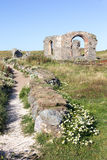 Church ruins. Pathway and church ruins on Llanddyn Island, Anglesey,Wales stock photography