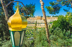 The church's lantern. The lantern in front of the Russian Orthodox Church of Mary Magdalene with the medieval walls of Jerusalem on the background, Israel stock photography