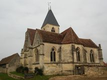 Church Saint-Denis in Chérence. Chérence, a small village in Ile-de-France, and its XIth century church. Vexin Français Regional Natural Park Royalty Free Stock Image