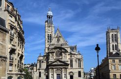 Church of Saint-Etienne du Mont in Paris, France. Church of Saint-Etienne du Mont against a blue sky in Paris, France stock images
