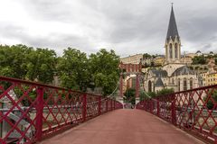 Church of Saint Georges and footbridge, Lyon, France. Panoramic view of Saint Georges church and pedestrian footbridge across Saon. Church of Saint Georges and royalty free stock photos