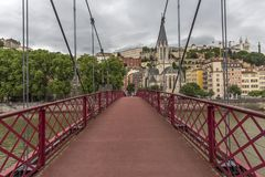 Church of Saint Georges and footbridge, Lyon, France. Panoramic view of Saint Georges church and pedestrian footbridge across Saon. Church of Saint Georges and stock photo