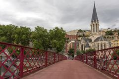Church of Saint Georges and footbridge, Lyon, France. Panoramic view of Saint Georges church and pedestrian footbridge across Saon. Church of Saint Georges and stock images