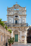 Church of Saint Lucia in Badia, Piazza Duomo, Ortigia, Siracusa,. Sicily, Italy against the blue sky in the raking light of the morning Royalty Free Stock Photos