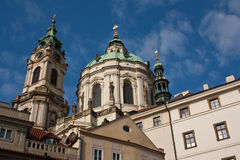 Church of saint nicholas. Towers of church of saint nicholas on Lesser Town Square in Prague Stock Image