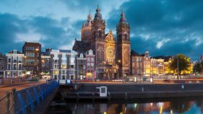 Church of Saint Nicholas in Amsterdam. Evening view on Church of Saint Nicholas in Amsterdam, Netherlands static image with animated sky and water stock video