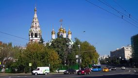 Traffic next to the Church of Saint Nicholas in Khamovniki, Moscow, Russia.. Church of Saint Nicholas in Khamovniki is a late 17th-century parish church of a stock video