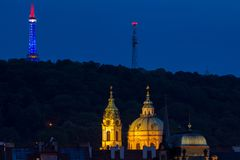 Church of Saint Nicholas  with lookout tower Petrin behind at evening Royalty Free Stock Images