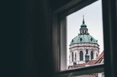 Church of Saint Nicholas in Prague. View from the window to St. Nicholas Church in Prague. This view you can see from one of the apartment in Tomášská street Stock Images