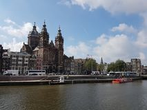 Church of Saint Nicholas from the river at Amsterdam, Netherlands stock photos