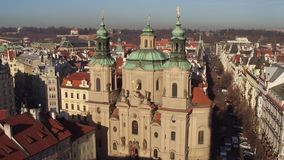 The Church of Saint Nicholas and tiled roofs old town in Prague on a sunny day, Czech Republic Royalty Free Stock Photography