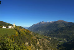 The church of Saint Nicolas in Aosta Valley. A view on the north italian Alps Stock Image