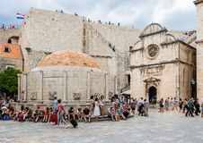 Church of Saint Saviour  and Onofrio`s Fountain in Dubrovnik`s O. DUBROVNIK, CROATIA - JULY 16th, 2016: Stradun street starting square in Old Town with the Royalty Free Stock Photos