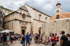 Church of Saint Saviour  and Onofrio`s Fountain at Pile Gate in. DUBROVNIK, CROATIA - JULY 16th, 2016: Stradun street starting square at Pile Gate in Old Town Royalty Free Stock Photos
