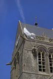 Church of Sainte-Mere-Eglise. Paratrooper hanging on the roof of the church of Sainte-Mere-Eglise in Normandy, France Stock Images